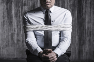 Fear and hopelessness. Cropped image of tied up businessman sitt